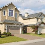 stock-photo-81149503(1)-brand-new-suburban-house-in-sunny-summer-afternoon