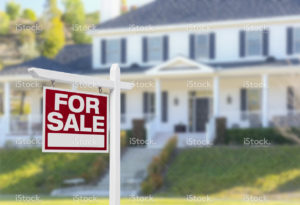 stock-photo-81773551-home-for-sale-sign-in-front-of-new-house